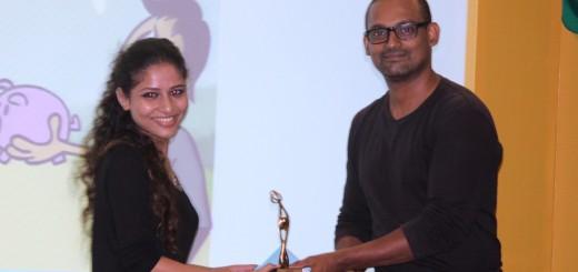 Devena Wins Award for Best Digital Illustrations. Devena receiving Award from Vaibhav More